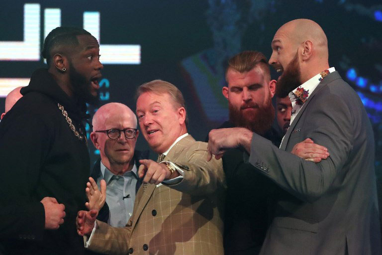 WBC world heavyweight champion, US boxer Deontay Wilder (L), and former world heavyweight champion, British boxer Tyson Fury (R) are seperated by boxing promoter and manager Frank Warren (C) during a press conference in London on October 1, 2018 ahead of their scheduled title fight on December 1. PHOTO/AFP