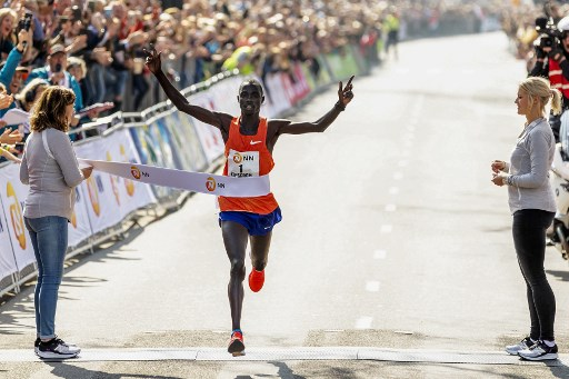 Winner Marius Kipserem from Kenya celebrates as he crosses the finish line of the 39th Rotterdam Marathon in Rotterdam, on April 7, 2019. PHOTO/AFP