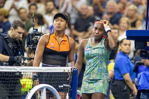 Winner Naomi Osaka of Japan console a crying Coco Gauff of the United States and asks her to conduct the on court interview with her after the Women's Singles round three match on Arthur Ashe Stadium during the 2019 US Open Tennis Tournament at the USTA Billie Jean King National Tennis Center on August 31st, 2019 in Flushing, Queens, New York City. PHOTO/ GETTY IMAGES