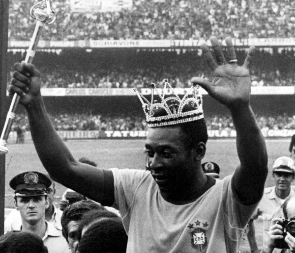 With crown on the head and holding a scepter, Pelé waves to audience as he leaves the field after farewell match, in São Paulo, southeastern Brazil, July 11, 1971. At game held at Morumbi Stadium, Brazil defeated Austria 1-0. PHOTO | AFP
