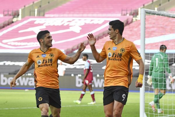 Wolverhampton Wanderers' Mexican striker Raul Jimenez (R) celebrates scoring the opening goal with Wolverhampton Wanderers' Portuguese midfielder Pedro Neto (L) during the English Premier League football match between West Ham United and Wolverhampton Wanderers at The London Stadium, in east London on June 20, 2020. PHOTO | AFP