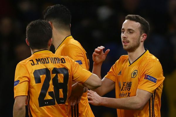 Wolverhampton Wanderers' Portuguese midfielder Diogo Jota (R) celebrates scoring the opening goal during the UEFA Europa League round of 16 first leg football match between Wolverhampton Wanderers and Espanyol at the Molineux stadium in Wolverhampton, central England on February 20, 2020. PHOTO | AFP