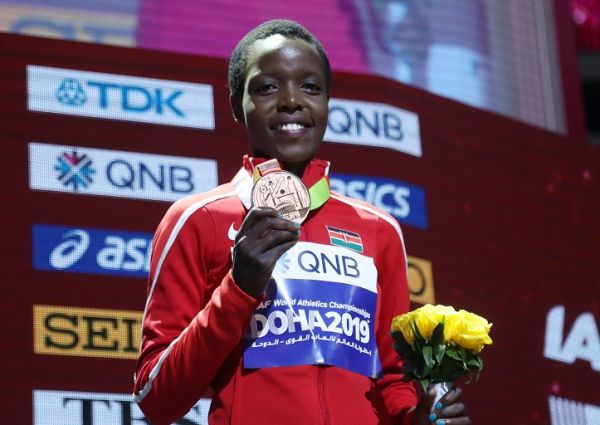 World Athletics Championships - Doha 2019 - Women's 10,000 Metres - Khalifa International Stadium, Doha, Qatar - September 29, 2019 Bronze medalist Kenya's Agnes Jebet Tirop during the medal ceremony. PHOTO   Alamy
