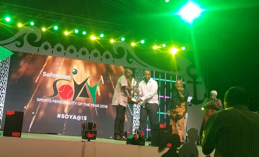 World marathon record holder, Eliud Kipchoge (left) receives the 2018 Male Sports Personality of the Year trophy from Mombasa Governor Hassan Ali Joho (centre) at the Safaricom Sports Personality of the Year Awards held at the Fort Jesus on Friday, January 11, 2018. PHOTO/Courtesy/Capital FM