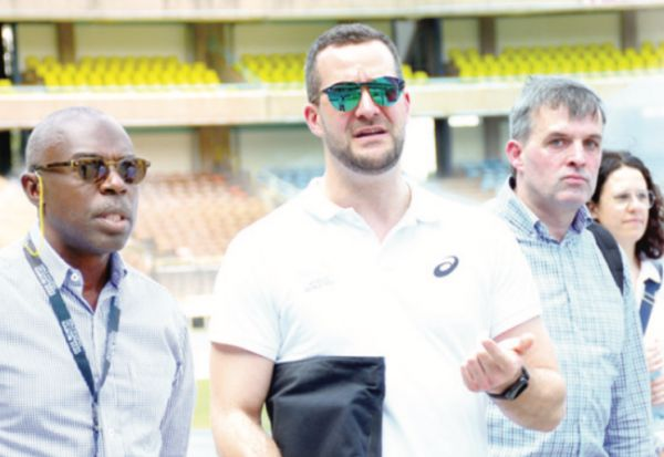 World U20 LOC boss Mike Rabar (left) with World Athletics officials at Kasarani Stadium last week. PHOTO | PD
