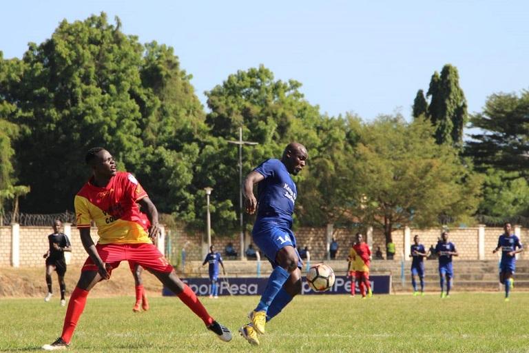 Wycliff Ochomo of Bandari FC (in Blue) tussle for the ball against a Vihiga United FC player at Mbaraki Stadium in Mombasa on February 12, 2019.PHOTO/BANDARI FC