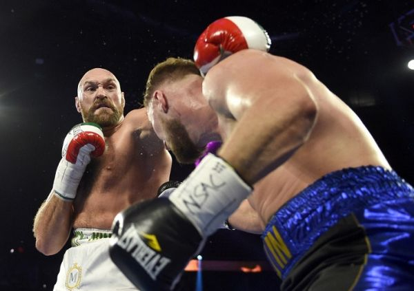 yson Fury (L) and Otto Wallin fight during their heavyweight bout at T-Mobile Arena on September 14, 2019 in Las Vegas, Nevada. Tyson won by an unanimous decision after the 12-round bout. PHOTO | AFP