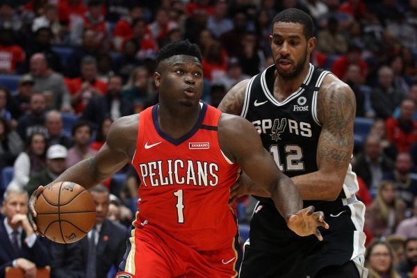Zion Williamson #1 of the New Orleans Pelicans drives the ball around LaMarcus Aldridge #12 of the San Antonio Spurs at Smoothie King Center on January 22, 2020 in New Orleans, Louisiana. PHOTO | AFP